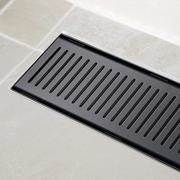 A Picture Of A Black Shower Grate